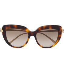 cartier eyewear panthère de cartier cat-eye frame sunglasses - brown