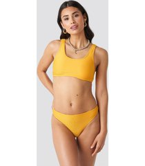 na-kd swimwear ribbed sporty bikini bottom - yellow