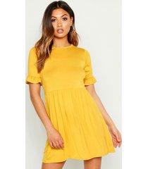 gesmokte jurk, mosterd