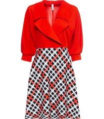 klänning med volang och rutig kjol