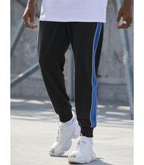 basics koyye pantalones casuales con bolsillo con rayas laterales a la moda para hombre