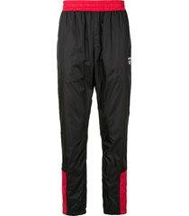 a bathing ape® contrast-panel track pants - black