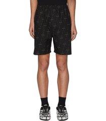 diagonal logo print shorts
