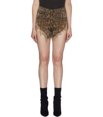 'shredded slouch' distressed leopard print denim shorts