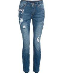 jeans med små stenar och destroyed-effekter