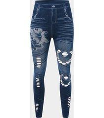 pantalones de diseño hueco con estampado floral azul