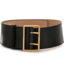 woman black and gold military belt