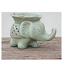 celadon ceramic oil warmer, 'elephant and leaf' (thailand)