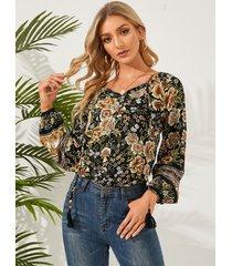blusa de manga larga con detalles de borlas nómadas negras de yoins