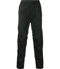 stone island crinkled-effect track pants - black