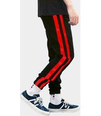 pantalones de chándal negros con dos tiras rojas en el lateral para hombre