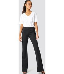 trendyol flare hem knitted trousers - black