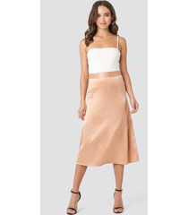 na-kd party bias cut satin midi skirt - beige