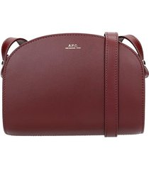 a.p.c. demi lune shoulder bag in bordeaux leather