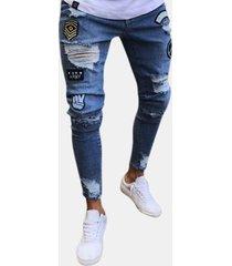 jeans in denim con strappi