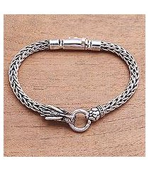 sterling silver pendant bracelet, 'clutching ring' (indonesia)
