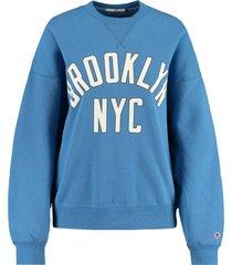 america today sweater sue