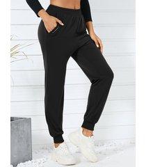 bolsillos laterales delanteros con cremallera yoins pantalones