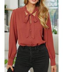 camicetta con bottoni annodati a maniche lunghe con scollo a v tinta unita per donna