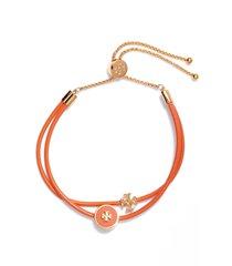 tory burch enamel logo slider bracelet in tory gold /mango at nordstrom