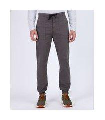calça de sarja masculina jogger com bolsos e cordão para amarrar chumbo