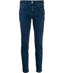 star-embossed skinny jeans