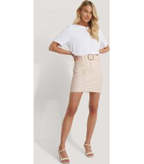 na-kd party faux leather belted mini skirt - beige