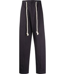 ann demeulemeester striped tie-waist trousers - blue