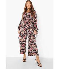 bloemen culotte jumpsuit met mouwstrikjes en open rug, black