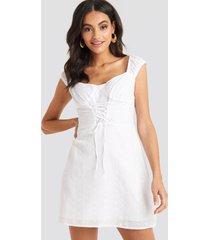 na-kd boho broiderie anglais lace up mini dress - white