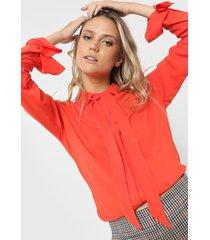 camisa naranja desiderata lhotse