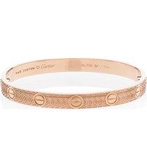 mad paris customised 18kt yellow gold cartier skull love bracelet