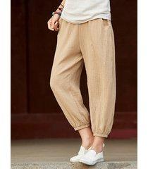 pantaloni tascabili harem in cotone color puro per le donne