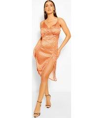 boutique satijnen slipdress in wikkelstijl met polkastippen, oranje