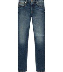-verf spetterde jeans