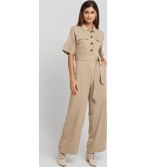 na-kd chest pocket buttoned jumpsuit - beige