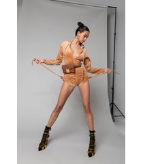 akira keep glowing romper with ruched shorts and hood