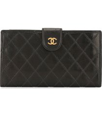 chanel pre-owned 1995 quilted cosmos wallet - black