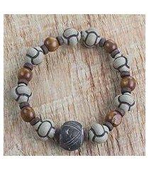 men's terracotta and wood beaded stretch bracelet, 'bold adventurer' (ghana)