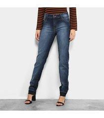 calça jeans skinny dimy estonada barra desfiada feminina