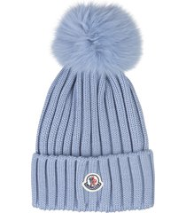 woman avio blue hat with fox pompon