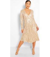 boutique midi-jurk met lovertjes en wikkelstijl, champagne