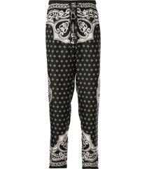 dolce & gabbana bandana print silk track trousers - black