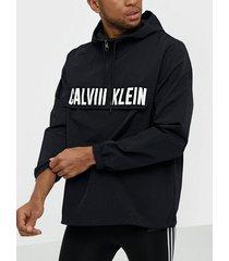 calvin klein performance 1/2 zip woven jacket träningsjackor black/white