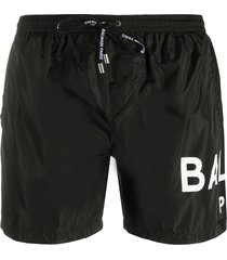 balmain logo print swim shorts - black