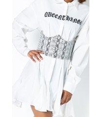 akira in the grass studded corset belt