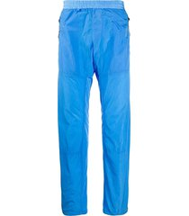 c.p. company crinkle effect elasticated waist track pants - blue