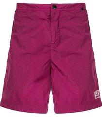c.p. company toggle swimming trunks - purple