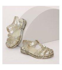 sandália infantil de tiras com glitter dourada