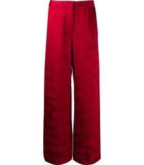 kirin all-over logo satin trousers - red